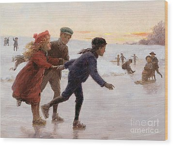 Children Skating Wood Print by Percy Tarrant