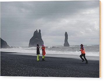 Wood Print featuring the photograph China's Tourists In Reynisfjara Black Sand Beach, Iceland by Dubi Roman