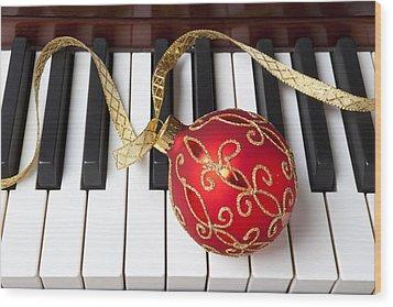 Christmas Ornament On Piano Keys Wood Print by Garry Gay