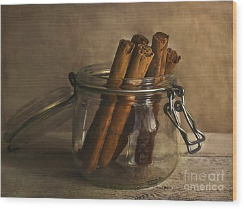 Cinnamon Sticks In A Glass Jar Wood Print by Elena Nosyreva