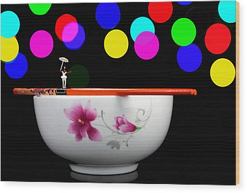 Circus Balance Game On Chopsticks Wood Print by Paul Ge
