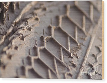 Close Up Of Motorcycle Tread Pattern On Muddy Trail Wood Print by Jason Rosette