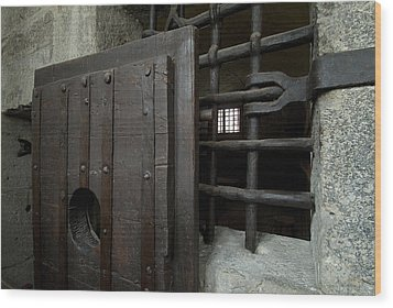 Close View Of Heavy Door To A Cell Wood Print by Todd Gipstein