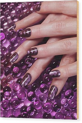Closeup Of Woman Hands With Purple Nail Polish Wood Print by Oleksiy Maksymenko