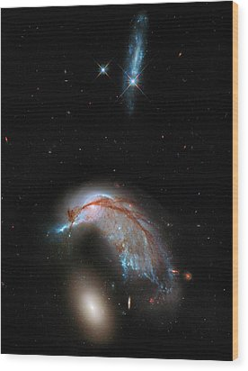 Wood Print featuring the photograph Colliding Galaxy by Marco Oliveira