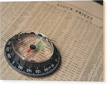 Compass On Stockmarket Cotation In Newspaper Wood Print by Sami Sarkis