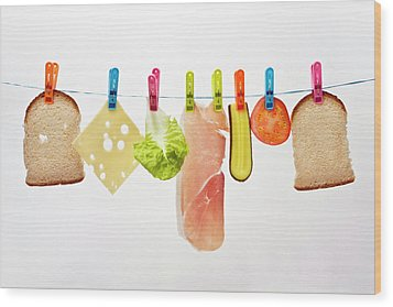 Components Of Sandwich Pegged To Washing Line Wood Print