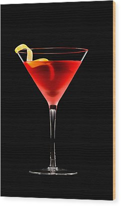 Cosmopolitan Cocktail In Front Of A Black Background  Wood Print by Ulrich Schade