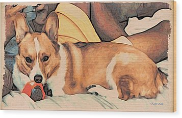 Wood Print featuring the digital art Couch Corgi Chewing A Ball by Kathy Kelly