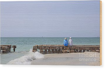 Couple Sitting On An Old Jetty Siesta Key Beach Florida Wood Print by Edward Fielding