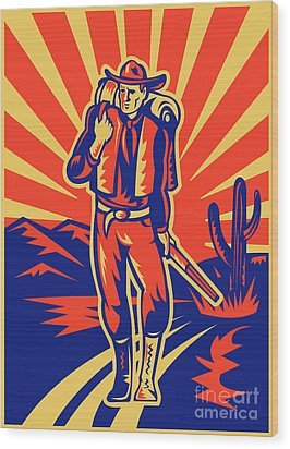 Cowboy With Backpack And Rifle Walking Wood Print by Aloysius Patrimonio