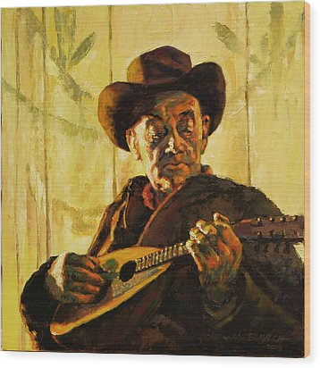 Cowboy With Mandolin Wood Print by John Lautermilch