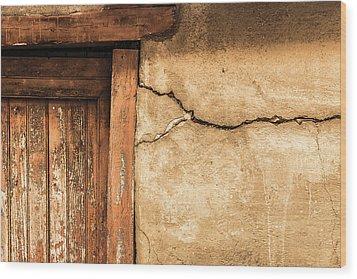 Cracked Lime Stone Wall And Detail Of An Old Wooden Door Wood Print by Semmick Photo
