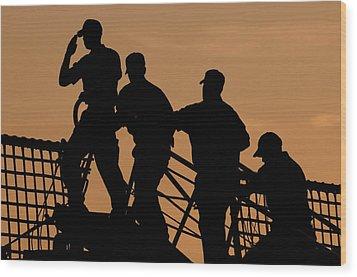 Crewmen Salute The American Flag Wood Print by Stocktrek Images