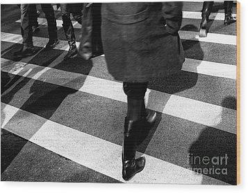 Crossings Black Boots Wood Print by John Rizzuto