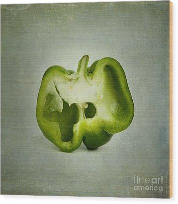 Cut Green Bell Pepper Wood Print by Bernard Jaubert