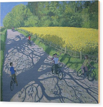 Cyclists And Yellow Field Wood Print by Andrew Macara