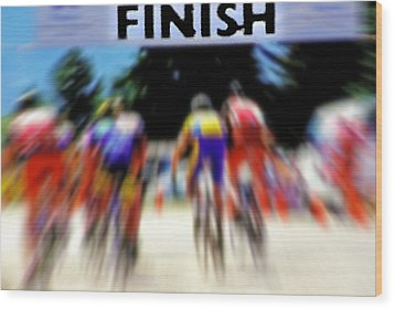 Cyclists Crossing The Finish Line Wood Print by Steve Ohlsen