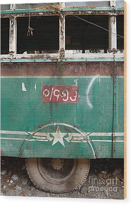 Dilapidated Vintage Green Bus In Burma - Side View With Tire Wood Print by Jason Rosette