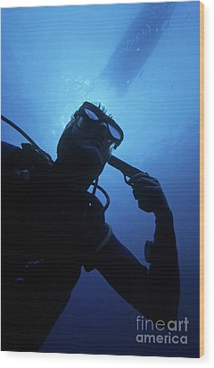 Diver Holding Gun To Head Underwater Wood Print by Sami Sarkis
