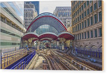 Dlr Canary Wharf And Approaching Train Wood Print by Venetia Featherstone-Witty