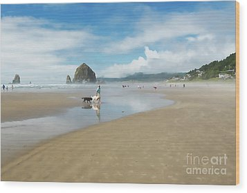 Dog Walking At Cannon Beach Wood Print