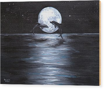 Dolphins Dancing Full Moon Wood Print by Bernadette Krupa