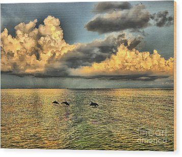 Dolphins Play At Sanibel Island Wood Print by Jeff Breiman