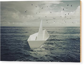 Wood Print featuring the photograph Drifting Paper Boat by Carlos Caetano