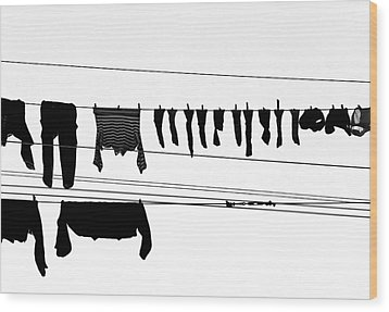 Drying Laundry On Two Clothesline Wood Print by Massimo Strazzeri Photography