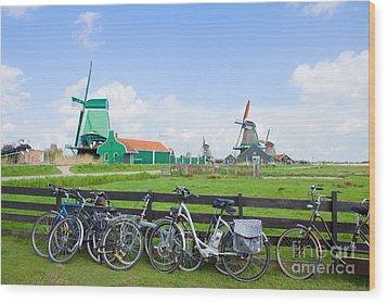 dutch windmills with bikes in Zaanse Schans Wood Print
