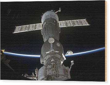 Earths Limb Intersects A Soyuz Wood Print by Stocktrek Images