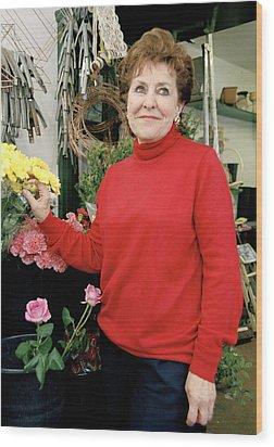 East London Flower Shop Owner Wood Print by Brian Benson