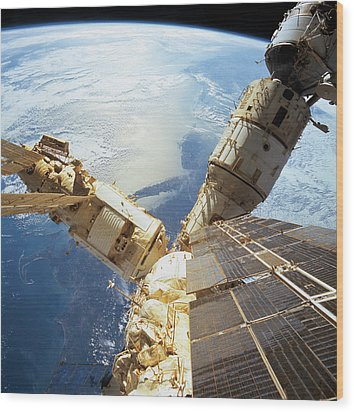 Elevated View Of A Space Station In Orbit Wood Print by Stockbyte