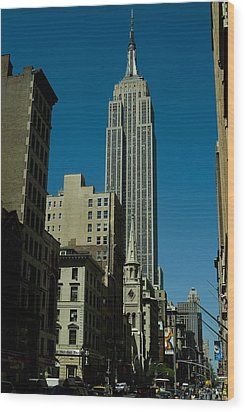 Empire State Building Seen From Street Wood Print by Todd Gipstein