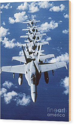 Fa-18c Hornet Aircraft Fly In Formation Wood Print by Stocktrek Images