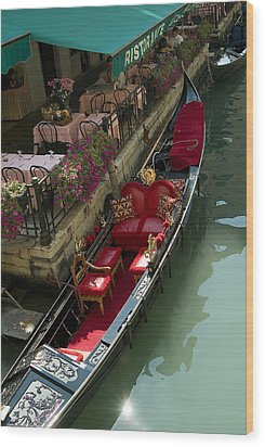 Fancy Gondola Parked In A Canal Next Wood Print by Todd Gipstein