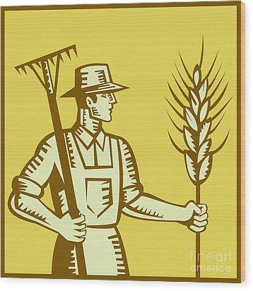 Farmer With Rake And Wheat Woodcut Wood Print by Aloysius Patrimonio