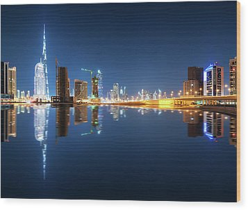 Fascinating Reflection Of Tallest Skyscrapers In Business Bay District During Calm Night. Dubai, United Arab Emirates. Wood Print