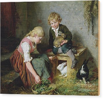 Feeding The Rabbits Wood Print