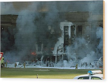 Firefighters Work To Put Out The Flames Wood Print by Everett