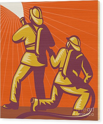 Firemen Aiming A Fire Hose Wood Print by Aloysius Patrimonio