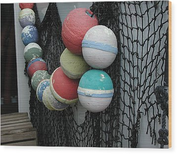 Wood Print featuring the photograph Fishing Buoys by Nancy Taylor