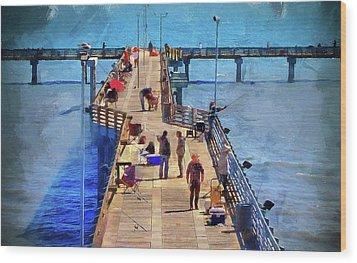Fishing Off Galvaston Pier Wood Print by Cedric Hampton