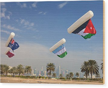 Flags Over Doha Wood Print by Paul Cowan