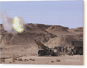 Flame And Smoke Emerge From The Muzzle Wood Print by Stocktrek Images