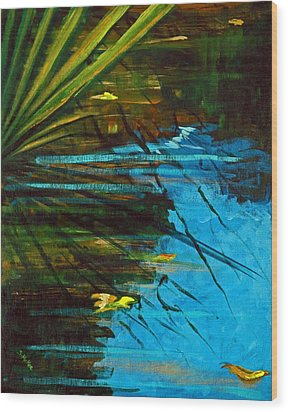 Floating Gold On Reflected Blue Wood Print by Suzanne McKee