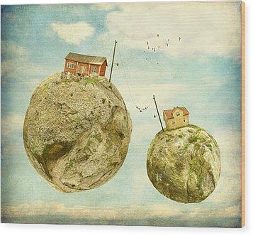 Floating Village Wood Print by Sonya Kanelstrand