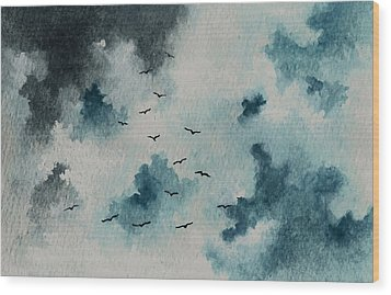 Flock Of Birds Against A Dark Sky  Wood Print by Michael Vigliotti