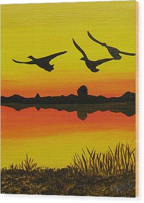 Flying Home Wood Print by Doug Wilkie